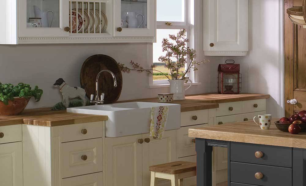 Farm house style kitchen with cream units